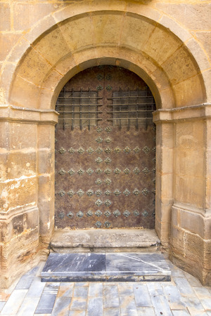 closed ribbon: old wooden door with iron ornaments
