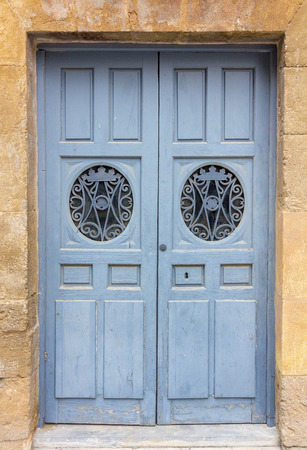 wooden door painted blue and decorated photo