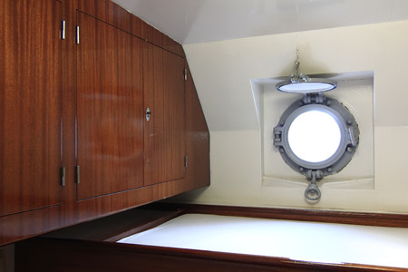 small cabin with porthole on a ship photo