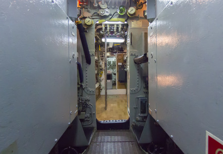 narrow corridor of ancient submarine photo