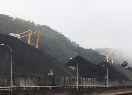 mountains of coal in a mine photo