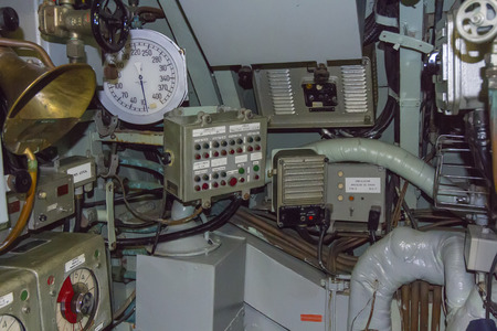 adjustment and control panels of an old submarine photo