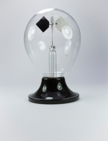 old Crookes radiometer operating on white background