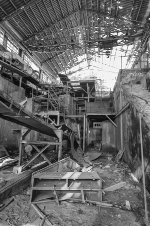 machinery destroyed in a coal mine abandoned after the war photo