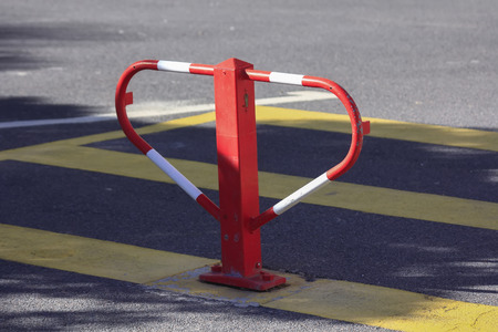 iron bollards red and white going over cars