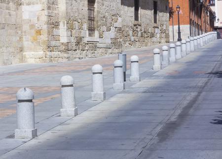 bollards: bollards to not park on the street