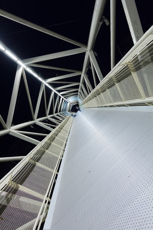 pedestrian walkway: details abstract bridge pedestrian walkway of Moneo, modern structure at night in Valladolid, Spain