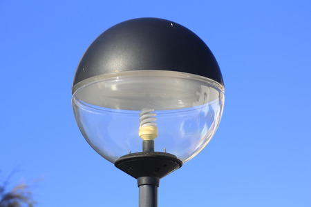 spherical lamp with energy saving light bulb photo