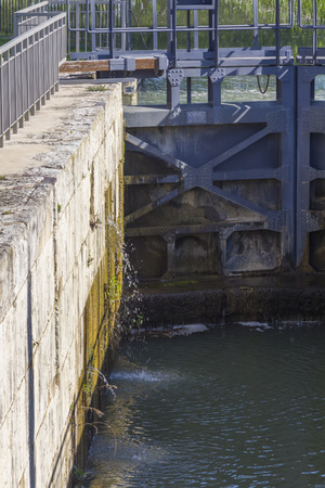 containment: Gates containment of water in a canal Stock Photo