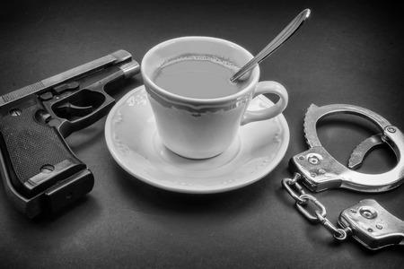 coffee detective, pipe gun and handcuffs photo