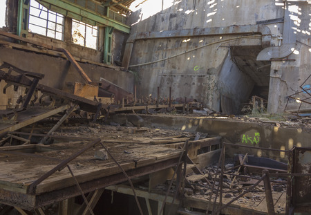 machinery destroyed in a coal mine abandoned after the war