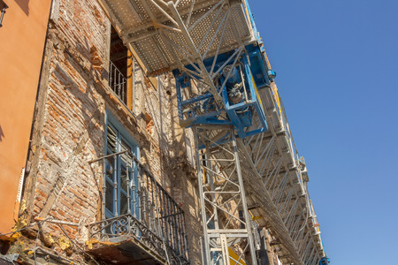facade of old building in remodeling, retaining outside photo