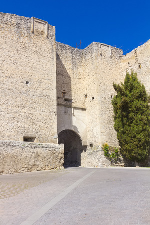 Old stone wall and entrance to the Mudejar era, the village of Cuellar, Spain