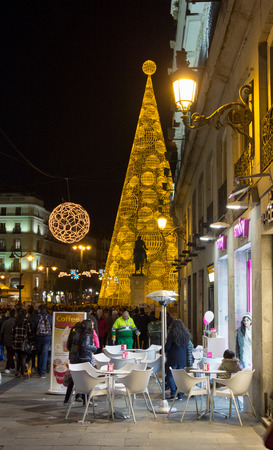 MADRID,SPAIN - DECEMBER 18: The streets of Madrid are filled with lights and people doing their Christmas shopping December 18, 2014 in Madrid Spain