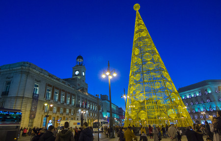 MADRID,SPAIN - DECEMBER 18: The famous Puerta del Sol crowded shopping for christmas December 18, 2014 in Madrid Spain Editorial