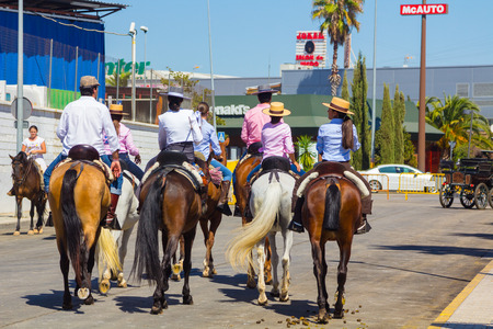 mounts: ANDUJAR,SPAIN - September, 6: men women and children involved walking on their mounts during the famous fair of the Andalusian horse on September, 6, 2014 in Andujar, Spain
