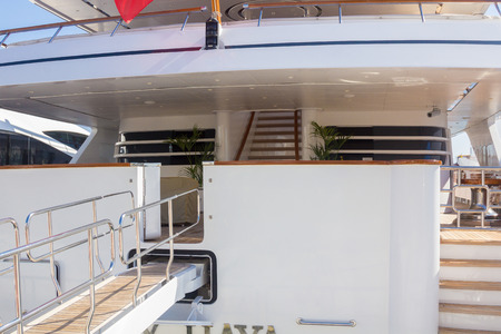 Wooden access ramp to a modern yacht