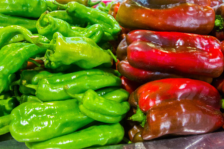 capsicum: Capsicum fresh green peppers and red flowers