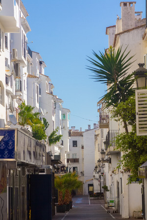 whitewashed: streets with whitewashed buildings typical of Puerto Banus, Malaga Spain Editorial