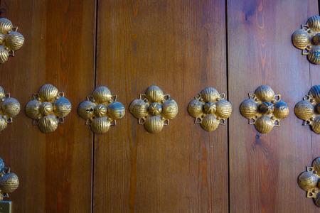 furniture hardware: background brass hardware on old wooden door Stock Photo