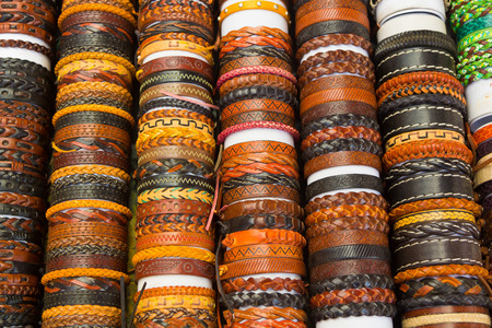 arm bands: leather bracelets with different shapes and colors Stock Photo