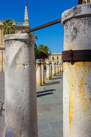 bollards: stone bollards around the Cathedral of Seville, Spain Stock Photo