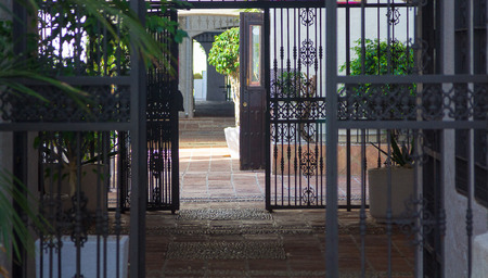 Typical entrance to a courtyard, with bars, Malaga Spain Editorial