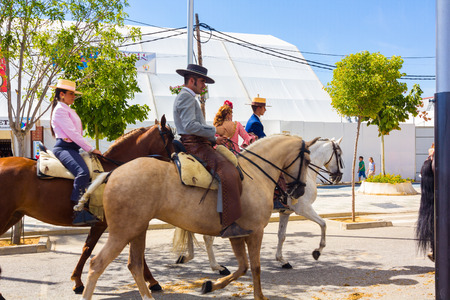 famous women: ANDUJAR,SPAIN - September, 6:  men women and children involved walking on their mounts during the famous fair of the Andalusian horse on September, 6, 2014 in Andujar, Spain