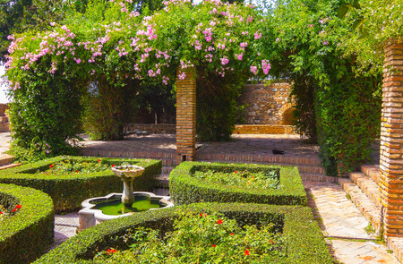 alcazaba: Courtyards and gardens of the famous Palace of the Alcazaba in Malaga Spain Editorial