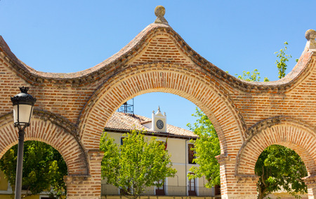pensacola: Arches and House with a clock in a village of Valladolid, Spain