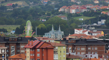 aviles: Overview and ferris wheel in the city of Aviles, Spain Stock Photo