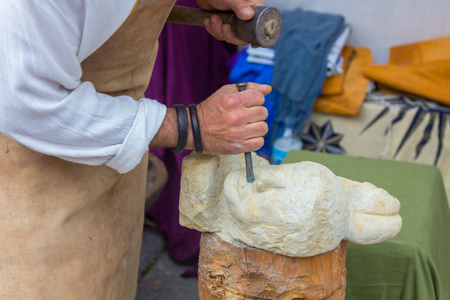 sculptor: Stone sculptor working with his tools Stock Photo