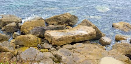 blue waters: Crystal blue waters along rocks with seaweed