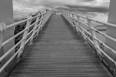 aviles: Iron bridge with wooden floors and rust by the sea, in Aviles, Spain Stock Photo