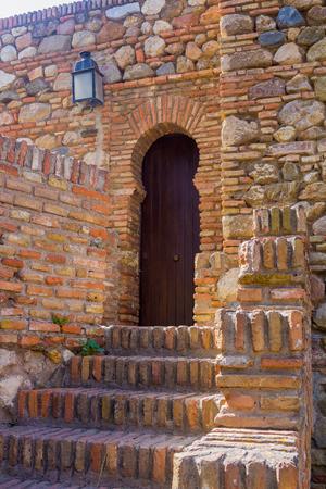 passageway: Ancient brick passageway door in the famous La Alcazaba in Malaga Spain Stock Photo