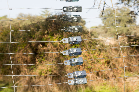 slack: Slack detail in a wire fence in countryside Stock Photo