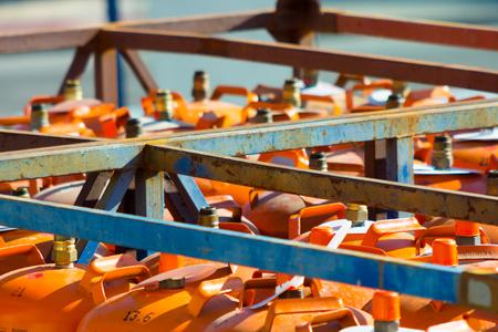 butane: Butane gas cylinders stored Stock Photo