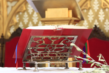lectern: Old lectern with a red book