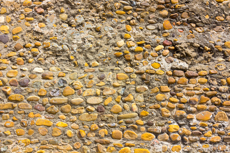 small stones: Wall background with small stones Stock Photo
