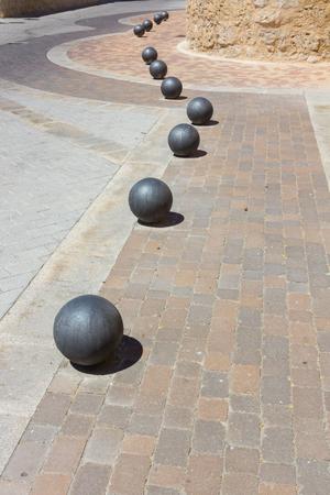 bollards: Spherical bollards on a sidewalk