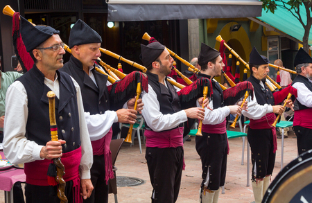 gaita: OVIEDO, Spain August 25, 2015: Group of bagpipers to parade through the streets to attract tourism in Oviedo, Spain