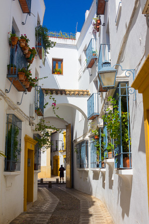 Streets decorated with bows and barred windows typical of the city of Cordoba, Spain