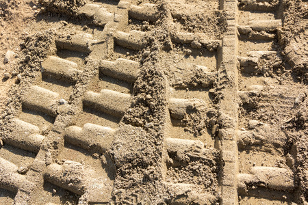 heavy machinery: Background with footprints in the sand of heavy machinery Stock Photo