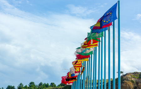 bandera de polonia: Regional flags of Spain in the wind over long blue poles