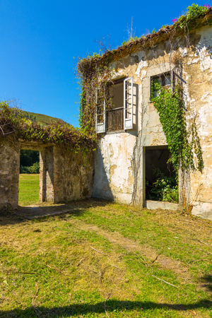 Old abandoned farmhouse in ruins Stock Photo