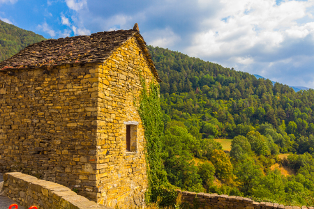 Solitary houses in the mountains of the natural park of ordesa huesca, spain Stock Photo