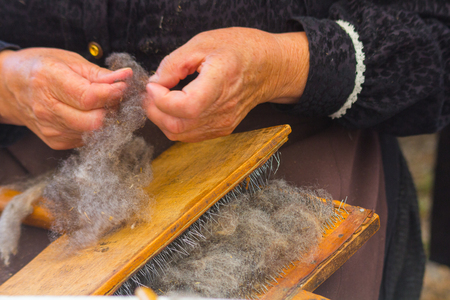 carding: AINSA 10 September 2017: women card wool as is to in antiquity in Ainsa Spain