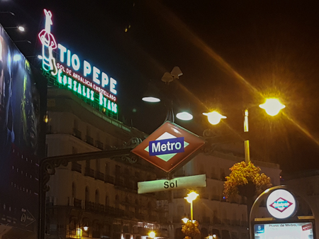 Madrid 26 August 2016: Famous poster of Tio Pepe in the Puerta del Sol during the Night in Madrid