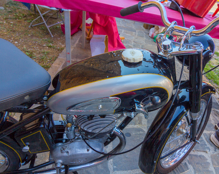 AINSA 10 September 2017: exhibition of old motorcycles, restored cars and tractors in Ainsa, Huesca Stock Photo - 90046252