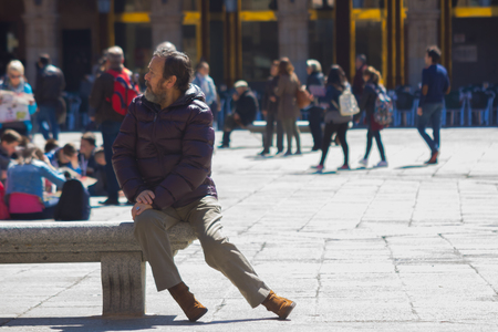 SALAMANCA 10 September 2017: people stroll a sunny winter day the center of the city in Salamanca Spain